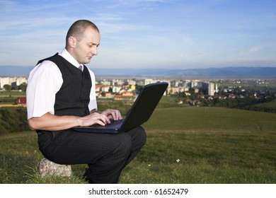 Freedom - Man working with laptop city in background