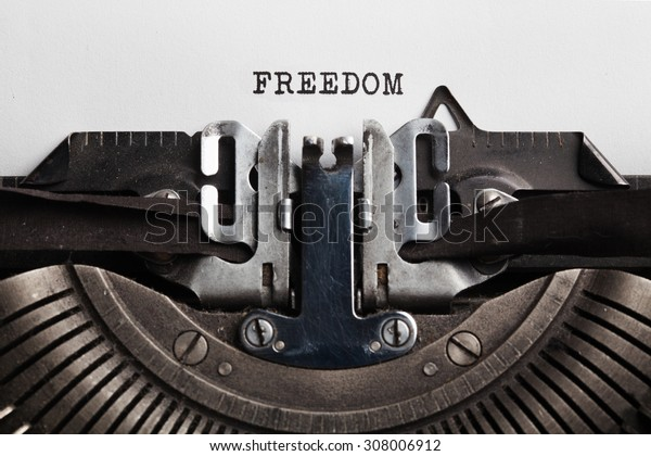 Freedom slogan written by a typewriter on a sheet of a paper