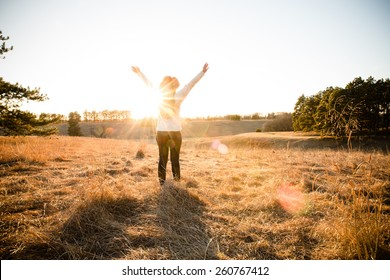 Freedom - This is a shot of a young woman wearing a hat enjoying the wide open spaces. Shot with a warm color tone.