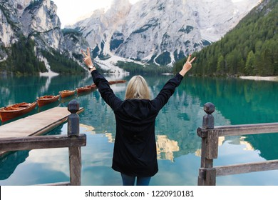Freedom of travel hiker on Lake Braies (Lago di Braies) in Dolomites Mountains, Italy. Hiking travel and adventure.