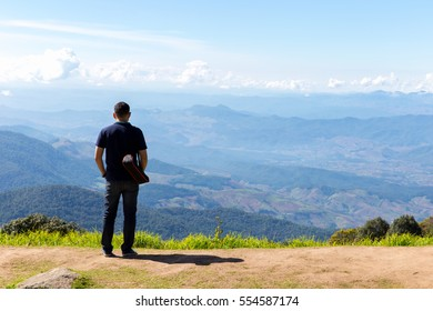 Freedom traveler man standing with pass pocket pant and enjoying a beautiful nature.