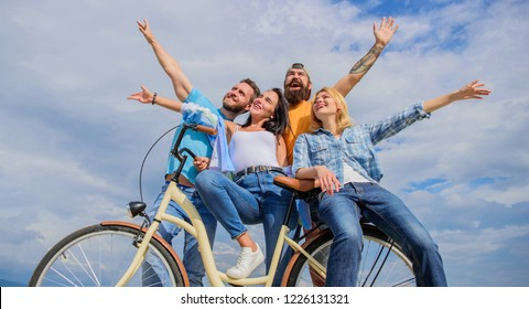 Freedom urban commuting. Bicycle as part of life. Company stylish young people spend leisure outdoors sky background. Cycling modernity and national culture. Group friends hang out with bicycle.