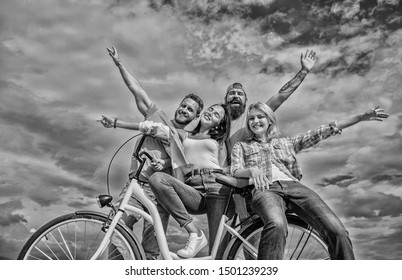 Freedom urban commuting. Bicycle as part of life. Cycling modernity and national culture. Group friends hang out with bicycle. Company stylish young people spend leisure outdoors sky background.