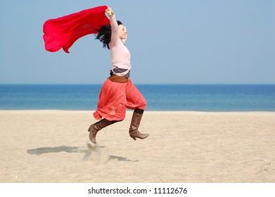 freedom woman on the beach