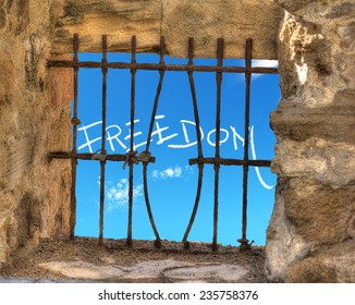 freedom writing seen through a jail window with bend bars
