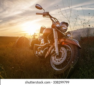 Freedom.Motorbike under sky.Vintage photo effect added for create atmosphere