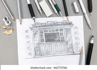 freehand sketch design of wall unit with pens and pencils on desk