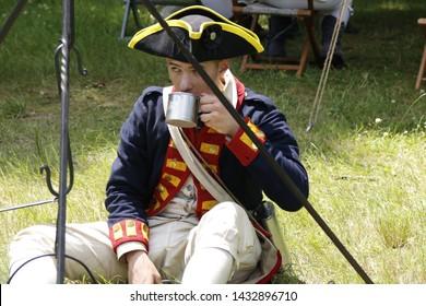 Freehold, New Jersey / USA - June 22, 2019: Revolutionary War colonial soldier reenactors in bluecoat uniforms