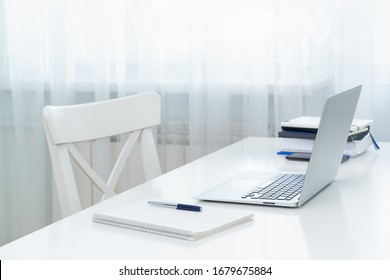Freelance Desk with laptop. Distance education. Quarantine, self-isolation, sociophobia. Online learning, teleworking, online lectures. Concept of digital nomads, home office, blogging. No people.