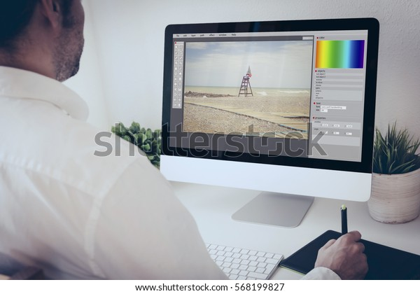 freelance photographer working with  computer and graphic pen