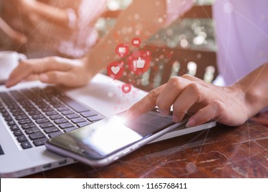 Freelance woman hand using laptop computer and smartphone for marketing or playing social media and website, Social network technology concept.