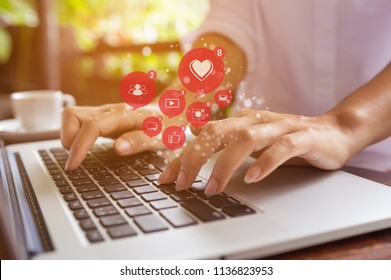 Freelance woman using laptop computer for marketing or playing social media and website, Social network technology concept.