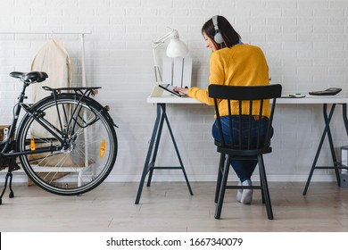 Freelance woman working in home office with laptop computer. Flexible workspace and working time.