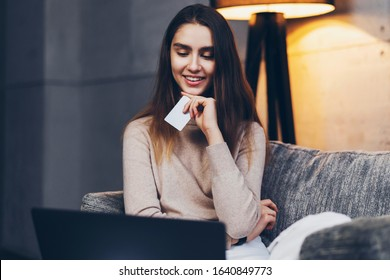 Freelance worker giving bank card number to client for salary payment. Girl buying goods online, selecting products for delivery and transferring money via Internet. Worldwide retailers offering goods