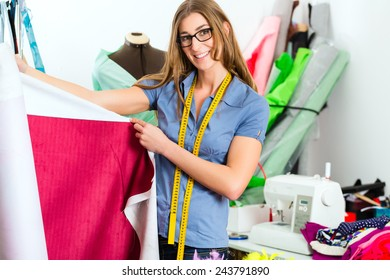 Freelancer - Fashion designer or Tailor working on a design or draft with colorful fabrics