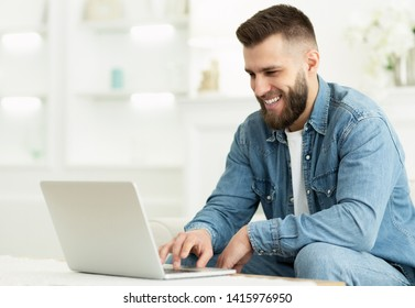 Freelancer Man Working On Laptop Online, Making New Project At Home