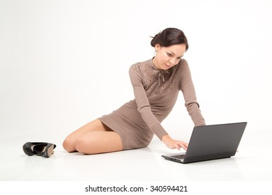 freelancer woman lay on the floor with notebook
