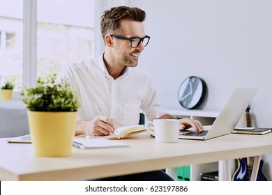 Freelancer working on laptop from home office