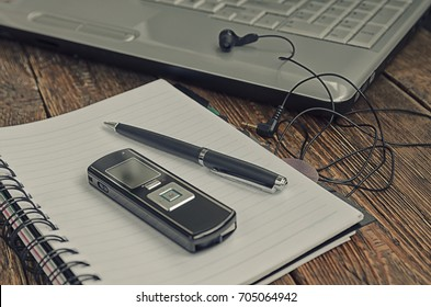 freelancer's work at a computer with a voice recorder