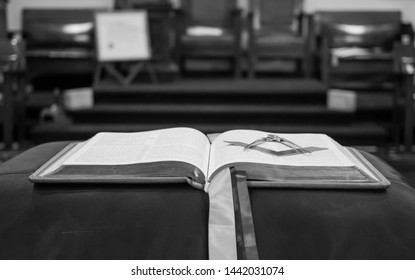 Freemasonry Square, compasses, and bible. The three great lights. Black and white.