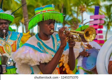 Freeport Bahamas - September 22, 2011: Male dancers dressed in traditional costumes performing at a Junkanoo festival playing a trumpet in Freeport, Bahamas
