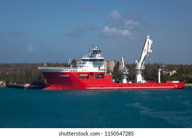 FREEPORT, GRAND BAHAMA ISLAND - JUNE 20, 2017: The offshore supply ship Oceanic is docked at Freeport Harbor. The oceanic sails under the flag of Malta.