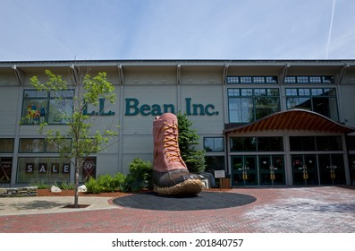 FREEPORT, MAINE, USA-JUNE 17, 2014: L.L.Bean is a privately held mail-order, online, retail company founded in 1912 by Leon Leonwood Bean. A replica of its famous boot stands in front of the store.