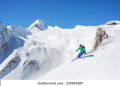 Freeride skiier in the mountains