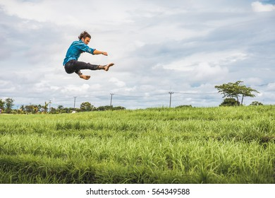 Freerunning rice paddies in Canggu, Bali, Indonesia.