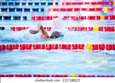 Freestyle swimmer in a race