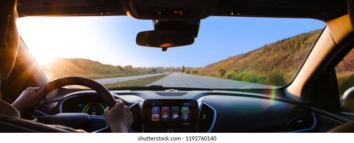 Freeway driving. Car driver view. Hands on the helm. Road to home.