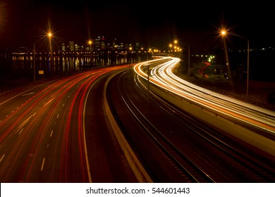 Freeway leading to Perth city with light trails