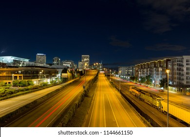 Freeway light trails leading into Tacoma Washington downtown city center at night