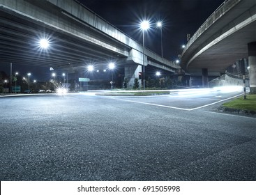 Freeway in night with cars light in crossroads