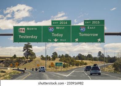 Freeway sign on western US highway New Year's concept yesterday today tomorrow as destinations exits for old and new year Easy update News MT Gothic Bold or Helvetica editable years to 2019 and 2020