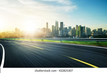 freeway at sunset, motion blur with city background .