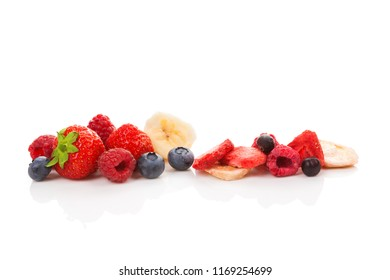 Freeze dried and fresh fruits isolated on white background. Healthy eating.