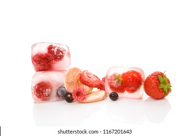 Freeze dried strawberries, raspberries, currants, blueberries and banana and berries frozen in ice cubes isolated on white background.