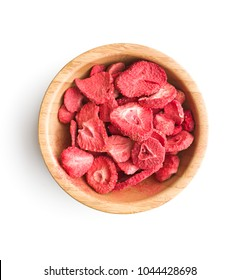 Freeze dried strawberry slices in bowl isolated on white background.