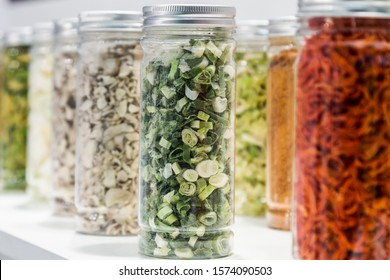 freeze dried vegetables sliced in glass jars in a shop window