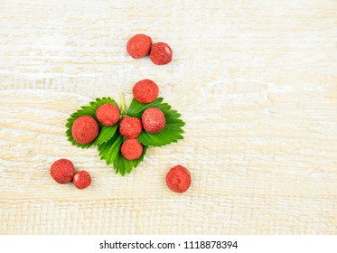 Freeze dried whole and pieces of strawberries on green strawberry. Freeze drying, also known as lyophilisation or cryodessication, is a low temperature dehydration process.