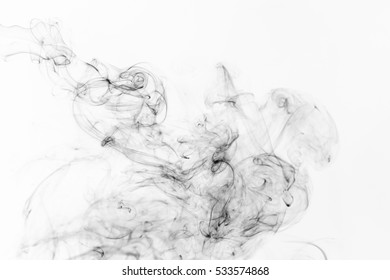 Freeze motion of black smoke isolated on white background. Abstract vape clouds