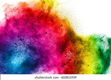 Freeze motion of colorful  painted powder exploding  on white background. Abstract design of color dust cloud. Particles explosion. Splash of colorful painted powder on white background.