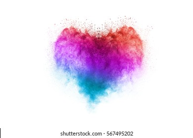 Freeze motion of heart shaped powder isolated on white, white background. Abstract design of dust cloud. Particles explosion screen saver, wallpaper with copy space. Love, passion, feelings concept