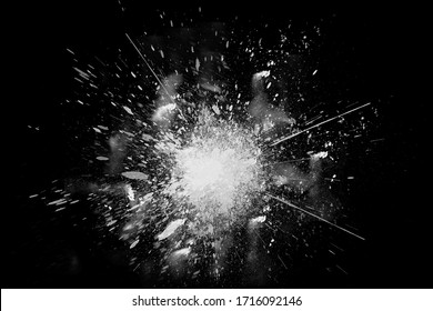 Freeze motion of white paint powder exploding, isolated on black, dark background. Abstract design of white dust cloud. Particles explosion screen saver, wallpaper copy space. Planet creation concept