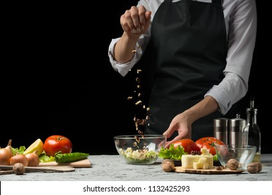 Freezer food prepare in process vegetarian salad by chef hand in home kitchen. Dark black background with Text area for design menu restaurant.Concept of healthy food, salad preparation