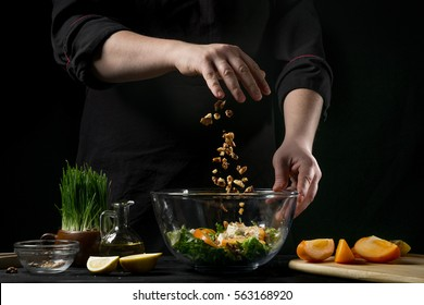 Freezer food prepare in process vegetarian salad by chef hand in home kitchen. Dark black background with Text area for design menu restaurant