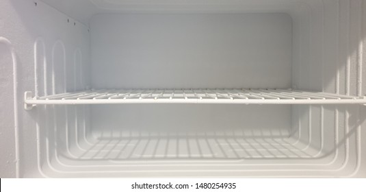 The freezer. Freezer in the refrigerator. Ice in the refrigerator.