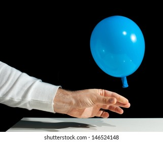 Freezing of a balloon that deflates on black background