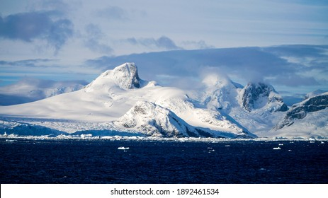 Freezing cold mountain and ice berg landscapes at the Lemaire Channel in Antarctica. - Shutterstock ID 1892461534